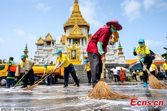 Disinfectant used to clean Wat Traimit temple in Bangkok