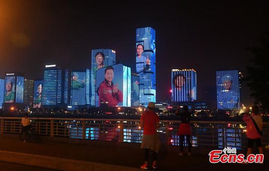 Landmark buildings lightened up for medical workers in Fuzhou