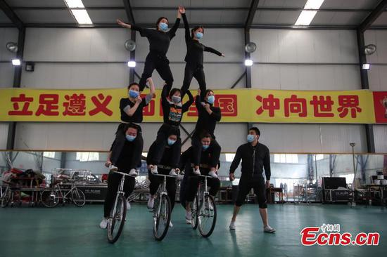 Acrobats train with masks on in SW China city