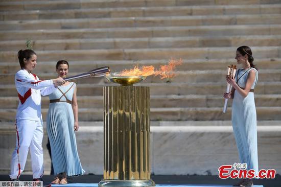 Olympic flame handed over to Japan amid coronavirus fears