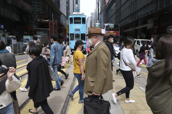 Hong Kong shuts bars as COVID-19 cases increase to 845