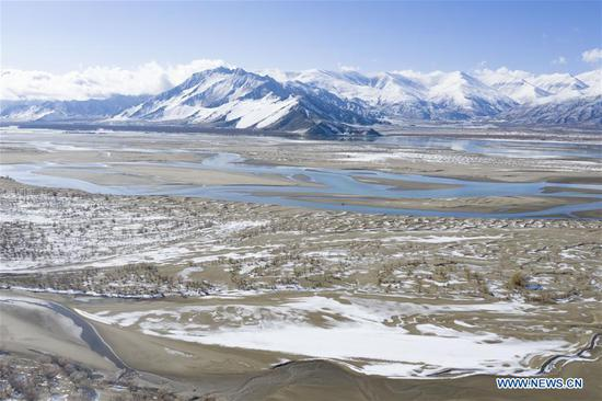 Scenery along Yarlung Zangbo River after snowfall