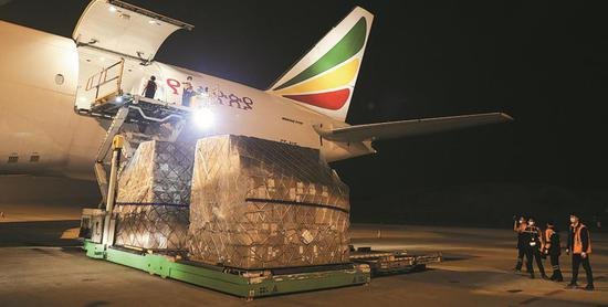 A cargo flight, chartered by logistics provider Cainiao Network Technology, is loaded with COVID-19 prevention and detection equipment for Africa in Guangzhou, Guangdong province, over the weekend. (Photo by Niu Jing/For China Daily)
