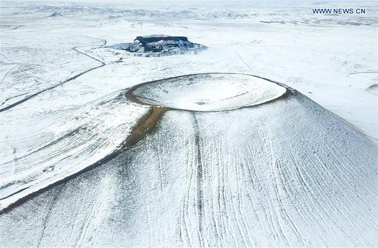 Volcano covered by snow in north China's Inner Mongolia