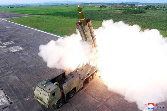 DPRK conducts test-firing of super-large multiple rocket launchers