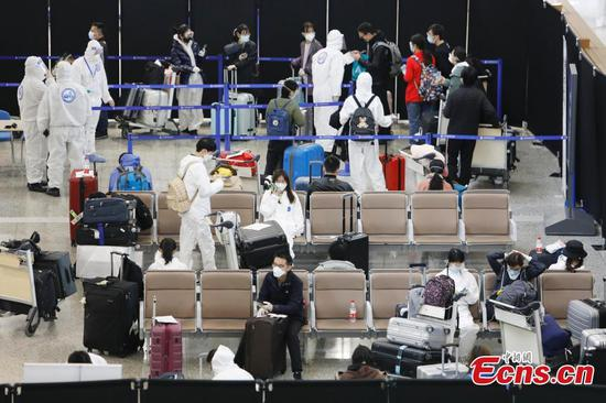 Shanghai tightens airport checks to block COVID-19 rebound