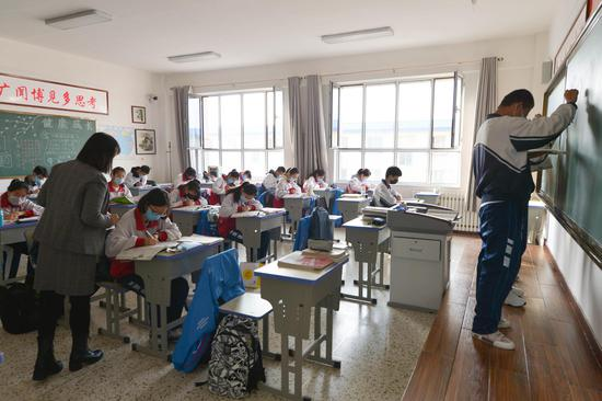 Schools begin to reopen in China amid strict measures