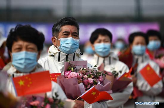 1st returned batch of medical workers finish quarantine in Tianjin