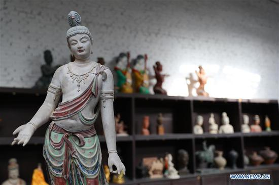 In pics: painted sculpture art in Dunhuang
