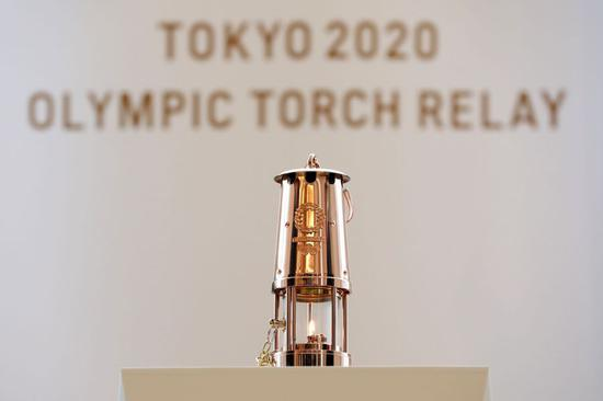 Photo taken April 1, 2020 shows the Olympic flame in a lantern at J-Village in Fukushima Prefecture, Japan. The flame will be on public display from April 2 to 30, due to the postponement of the Tokyo 2020 Olympic Games. (Tokyo 2020/Handout via Xinhua)