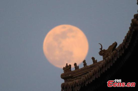 In pics: Full moon seen on sky in Beijing