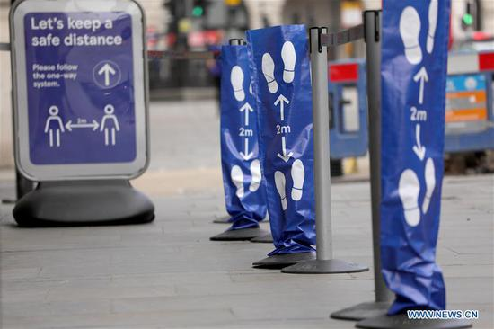 Signs shown in London to encourage social distancing