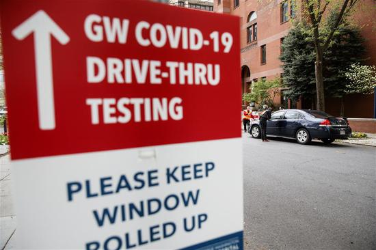 Medical workers take samples at drive-thru testing site in George Washington University Hospital