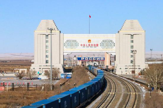 A freight train departing from Manzhouli City in north China's Inner Mongolia Autonomous Region passes through China-Russia border on Feb. 19, 2020. (Xinhua/Guo Nailun)