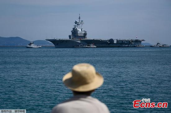 1,900 crew of French aircraft carrier go into quarantine after outbreak