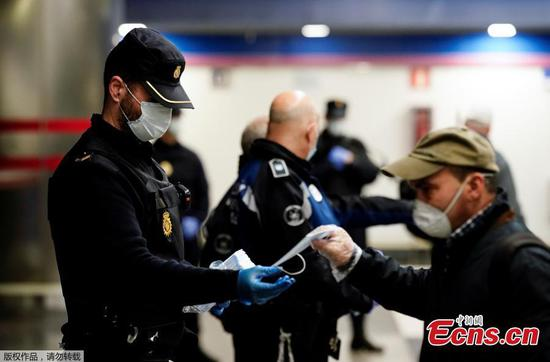 Free masks offered at metro station in Madrid