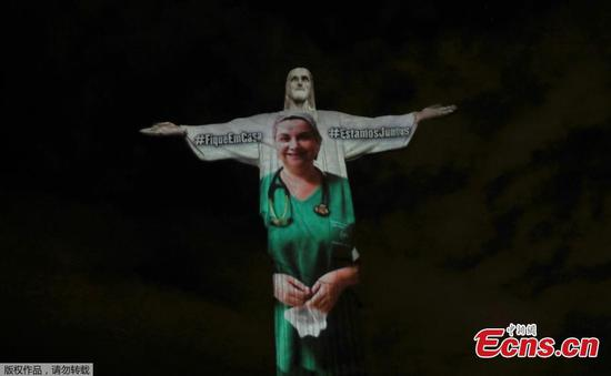 Christ the Redeemer lit up with message of thanks amid coronavirus pandemic