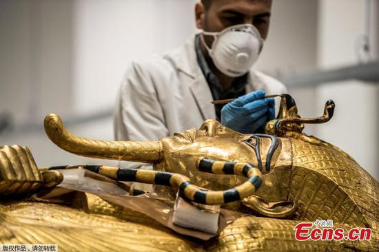 In pics: Restoration on King Tutankhamun gilded coffin