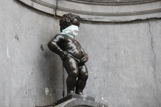 The Manneken Pis (Little Pissing Man) wearing a mask is seen in Brussels, Belgium, April 13, 2020. (Xinhua/Zheng Huansong)