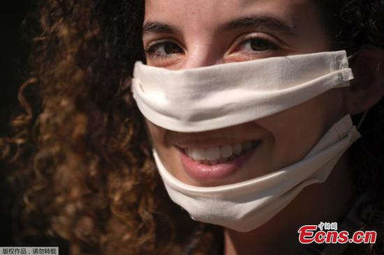 French woman makes lip-readable masks for those in need