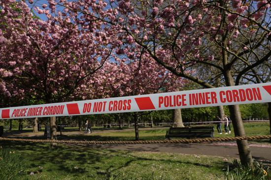 An area is taped off to prevent people getting into the blossoms in Greenwich Park in London, Britain, on April 13, 2020. (Photo by Tim Ireland/Xinhua)