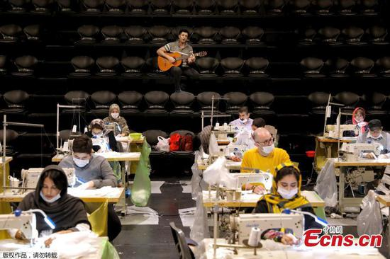 Theater converted into mask factory in virus-hit Iran