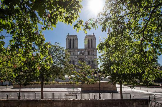 Notre Dame Cathedral marks fire anniversary under COVID-19 lockdown