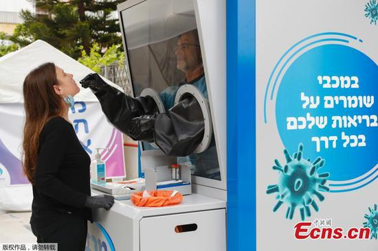 COVID-19 testing booth installed on street in Israel