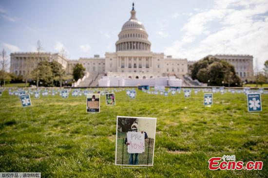 Advocates place 1,000 signs on Capitol Lawn to demand safety equipment for frontline workers