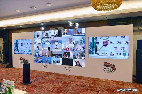 Photo taken on Apirl 19, 2020 in Riyadh, Saudi Arabia shows G20 health ministers attending a virtual meeting.  (G20 Saudi Arabia/Handout via Xinhua)