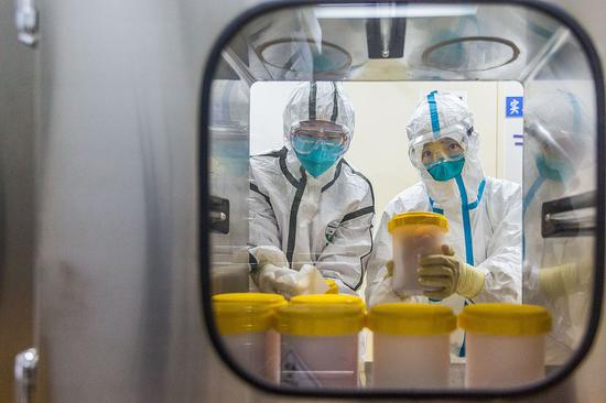 China's sharing coronavirus strains with international community active and open: official