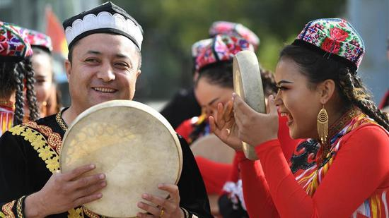 A culture and tourism festival themed on Dolan and Qiuci culture in Awat County of Aksu Prefecture, northwest China's Xinjiang Uygur Autonomous Region, October 25, 2019. (File photo/Xinhua)