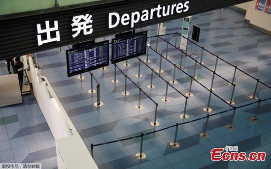 """随着COVID-19案件的增加,东京的羽田机场""""几乎空了"""""""