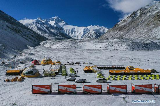 Aerial photo taken on April 30, 2020 shows the Mount Qomolangma base camp at the foot of the peak in southwest China's Tibet Autonomous Region. China on Thursday initiated a new round of measurement on the height of Mount Qomolangma, the world's highest peak. (Xinhua/Purbu Zhaxi)