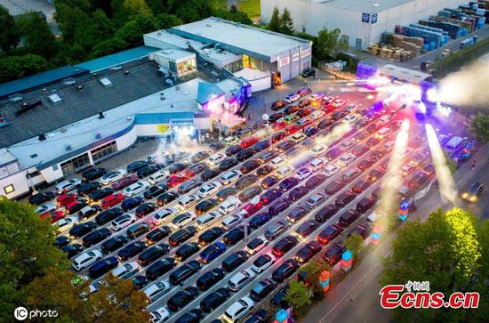 Hundreds celebrate car disco under virus restrictions in Germany
