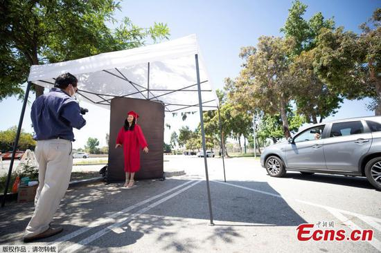 Drive-thru photostudio set up for graduating students amid outbreak