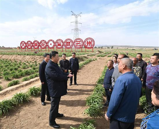 Chinese President Xi Jinping, also general secretary of the Communist Party of China Central Committee and chairman of the Central Military Commission, learns about poverty alleviation efforts at an organic daylily farm in Yunzhou District of Datong City, north China's Shanxi Province, May 11, 2020. Xi inspected north China's Shanxi Province on Monday. (Xinhua/Li Xueren)