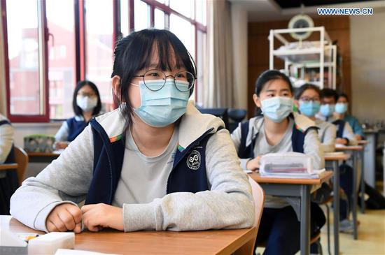 Students attend class at Beijing National Day School - Longyue in Haidian district of Beijing, capital of China, May 11, 2020. (Photo/Xinhua)