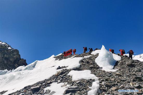 Chinese remeasuring surveyors hike toward advance camp on Mount Qomolangma