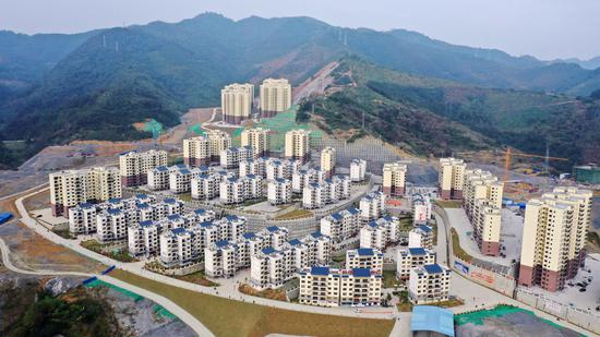 Aerial photo taken on Dec. 3, 2019 shows a poverty-relief resettlement site in Longlin County, south China's Guangxi Zhuang Autonomous Region. (Xinhua/Zhang Ailin)