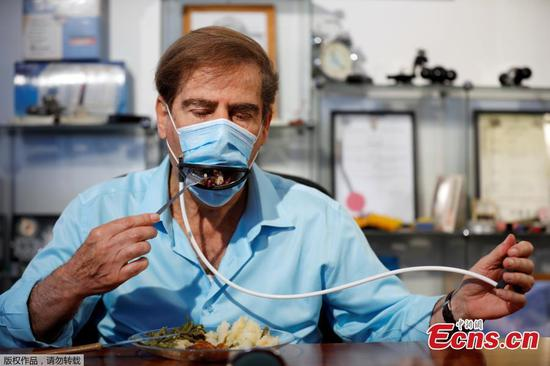 New-type mask enables diners to eat without taking it off