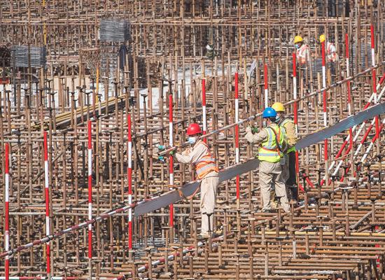 People work at the construction site of the Joy City building complex in Wuhan, central China's Hubei Province, April 28, 2020. (Xinhua/Xiao Yijiu)