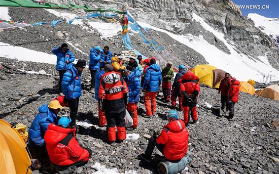 Remeasuring team announces list of 12 people to climb to peak of Mount Qomolangma