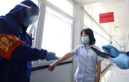 Beijing normalizes novel coronavirus measures