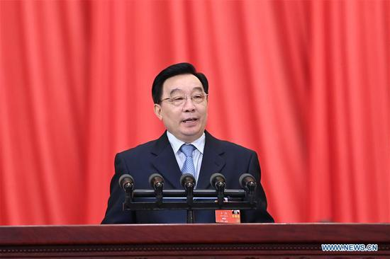 Wang Chen, vice chairman of the Standing Committee of the National People's Congress (NPC), speaks at the opening meeting of the third session of the 13th NPC at the Great Hall of the People in Beijing, capital of China, May 22, 2020. Wang read an explanatory document on the draft civil code to deputies attending the third session of the 13th NPC and explained the draft decision on establishing and improving the legal system and enforcement mechanisms for the Hong Kong Special Administrative Region (HKSAR) to safeguard national security to the session. (Xinhua/Shen Hong)