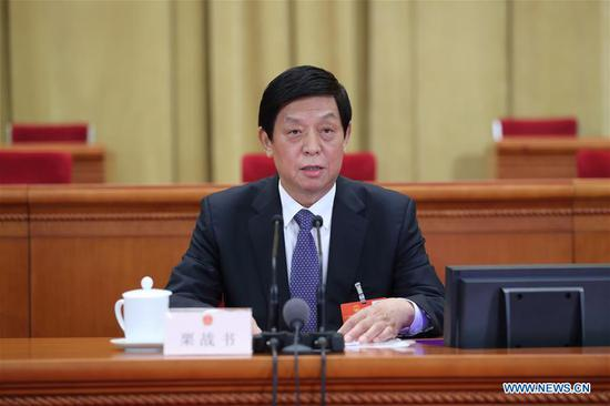 Li Zhanshu, chairman of the National People's Congress (NPC) Standing Committee, presides over a preparatory meeting for the third session of the 13th NPC at the Great Hall of the People in Beijing, capital of China, May 21, 2020. (Xinhua/Ju Peng)