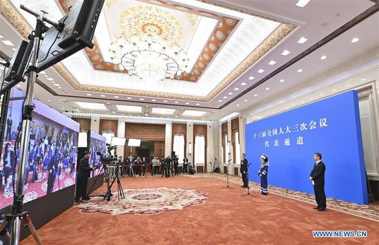 NPC deputies receive interview ahead of annual session