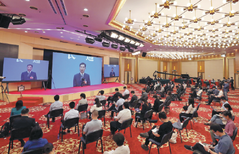 Finance Minister Liu Kun answers reporters' queries online after the opening of the NPC session on Friday in Beijing. WANG JING/CHINA DAILY