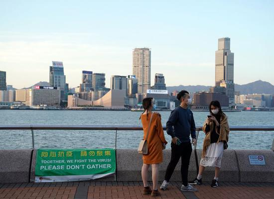 A poster reminding people not to gather is seen in Hong Kong, south China, April 12, 2020. (Xinhua/Li Gang)
