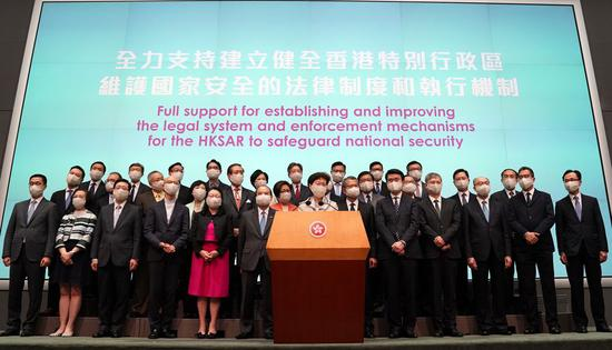Chief Executive of the Hong Kong Special Administrative Region (HKSAR) Carrie Lam (C), multiple other government officials and members of the Executive Council attend a press conference on introducing the national security legislation for HKSAR in Hong Kong, south China, May 22, 2020. (Xinhua/Li Gang)